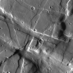 Where fractures and grabens cut across each other, scientists can determine the relative timing of the events by examining which features intersect which others. Here several fractures that trend from upper left to lower right cut across fractures trending from upper right to lower left. Which is younger? (NASA/JPL-Caltech/Arizona State University)