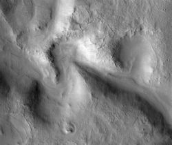 The winding channel of Huo Hsing Vallis has meanders like those in stream valleys on Earth. These suggest the valley was carved by flowing water. (NASA/JPL-Caltech/Arizona State University)