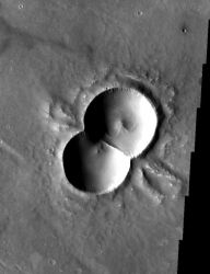 This THEMIS image shows both a doublet crater and an oblique crater. Both very unusual. (NASA/JPL/ASU)