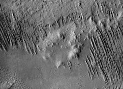 In Gusev Crater winds from the northwest (upper left) have carved soft materials (probably volcanic ash) into long ridges called yardangs. (NASA/JPL-Caltech/Arizona State University)