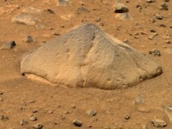 Adirondack rock, a piece of basalt about the size of a football, was the first rock examined by Mars Exploration Rover Spirit after it landed in Gusev Crater. Although it has a lot of reddish dust on its surfaces, the rock's angular shape indicates it has been eroded by wind-blown sand and dust. (NASA/JPL-Caltech/Cornell University)