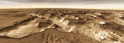 West of Valles Marineris lies a vast checkerboard of canyons named Noctis Labyrinthus. These formed when the Martian crust stretched and fractured, perhaps from the tectonic and volcanic activities that built Tharsis. As faults opened, they released subsurface ice and water, causing the ground to collapse and erode the cayons. (NASA/JPL-Caltech/Arizona State University)