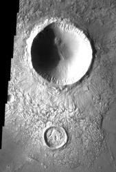 Two impact craters in this image help us to determine their relative ages. The smaller crater to the south formed first. It was then filled with ejecta from the younger and larger crater just to the north. If the sequence had been reversed, the smaller crater would not be filled with debris. (NASA/JPL-Caltech/Arizona State University)